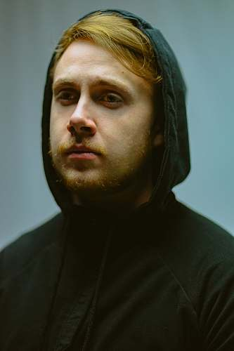 people man in black pullover hoodie person