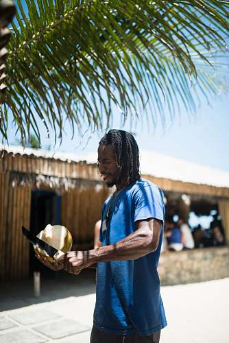 people man peeling coconut person