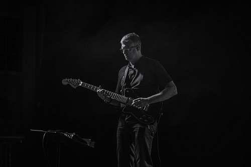 people man playing guitar black-and-white