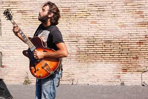 people man playing jazz guitar person