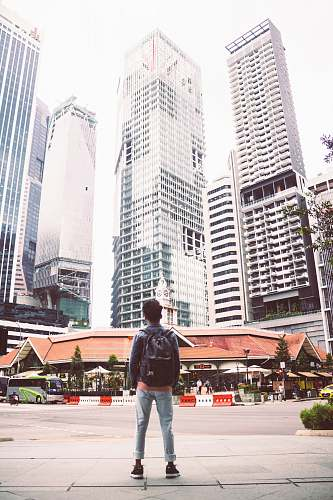 person man standing in front of building people