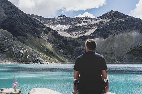 people man standing in front of mountain snow