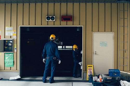 people man standing in front of open doorway person