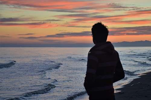 people man standing in front of seashore sea
