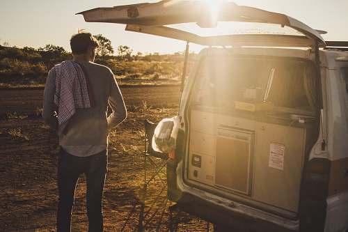 people man standing near white van during daytime person