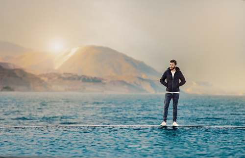 people man standing on body of water person
