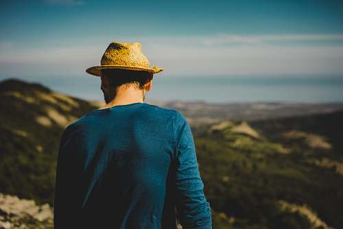 people man standing on hill hat