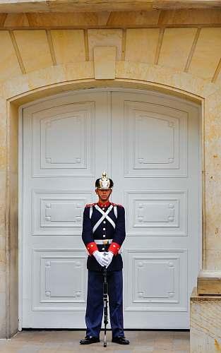 people man standing on white door person