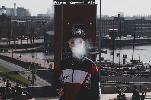people man standing while smoking person