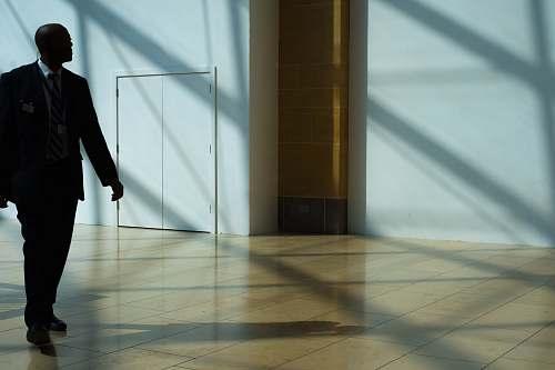 people man walking on hallway person