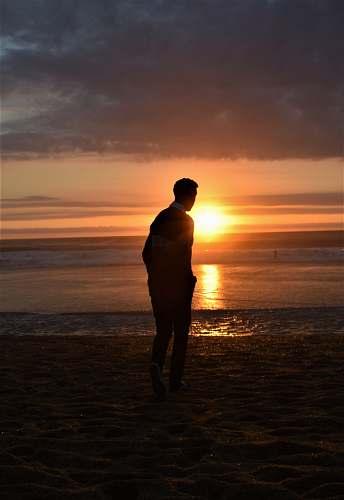 people man walking seashore beach