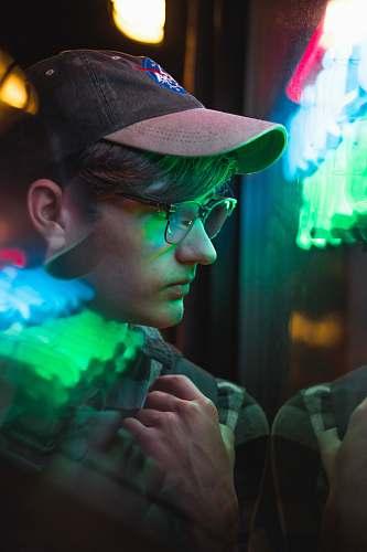 person man wearing black framed eyeglasses near green lights people