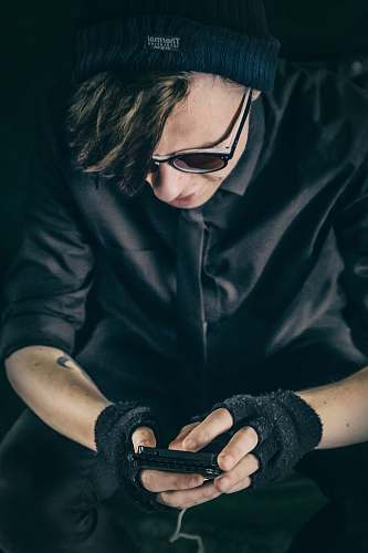 people man wearing black top using smartphone person