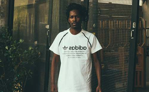 people man wearing white and black adidas crew-neck t-shirt person