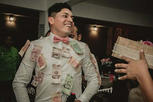 people man wearing white formal suit with banknotes hanging person