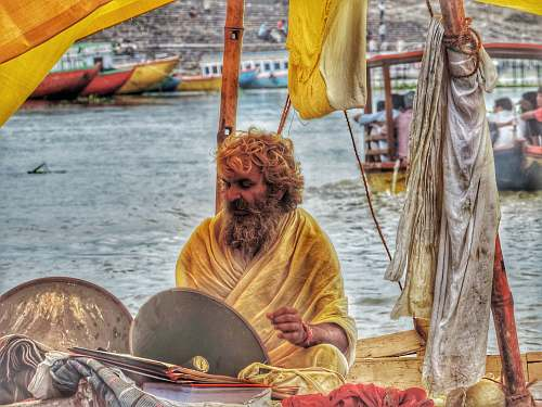 person men's yellow traditional dress boat
