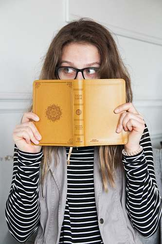 people person holding book person