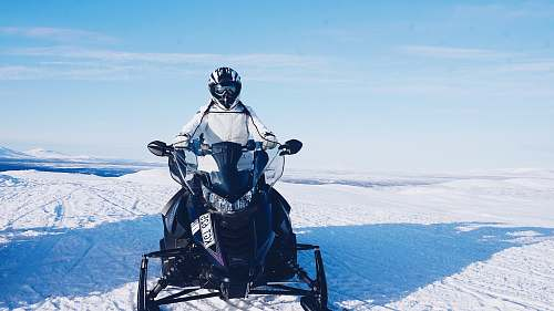 people person riding on snowmobile person