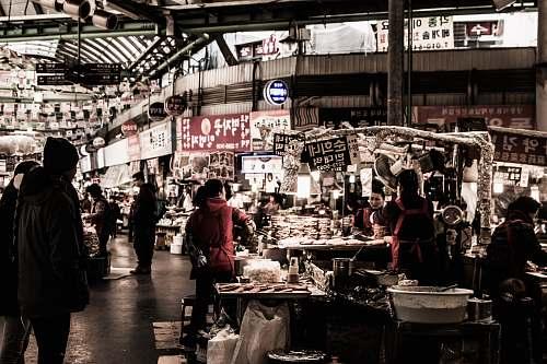 people photo people standing inside grey concrete building market