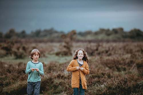 people shallow focus photography of children walking person