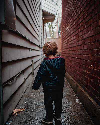 people shallow focus photography of toddler in alley person