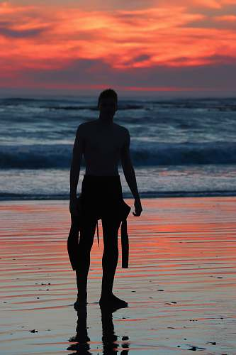 person silhouette of man near ocean people