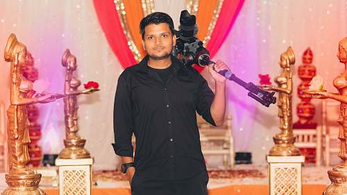 people smiling standing man carrying camera person