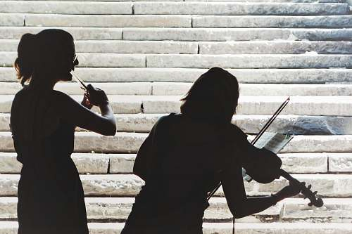 people two women playing violin and flute person