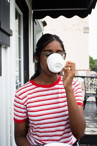 people woman drinking coffee outside house person