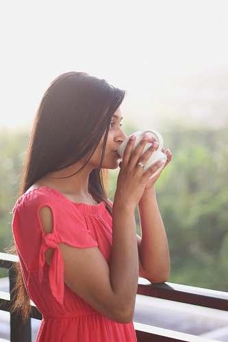 person woman drinking on white ceramic mug people