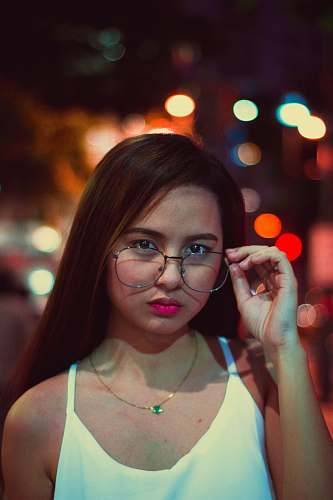 person woman holding eyeglasses people