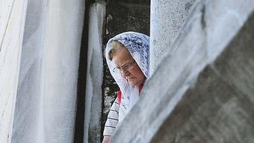 people woman peeking on window person
