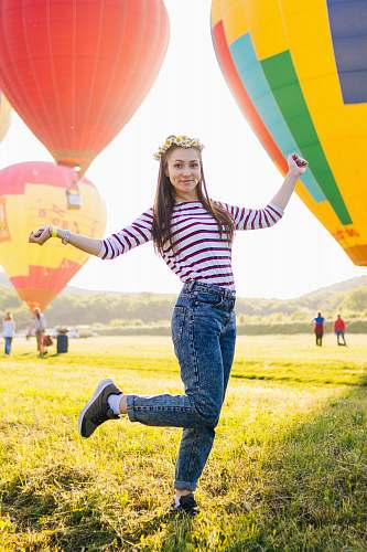 photo people woman posing on grass field surrounded with hot air balloons balloon free for commercial use images