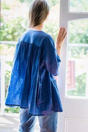 people woman standing beside door person