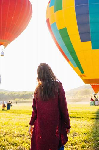 photo person woman standing near hot air balloon balloon free for commercial use images