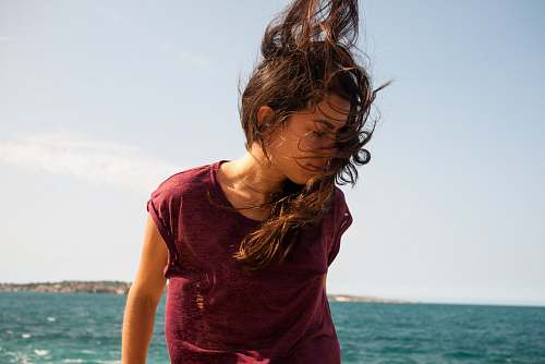 people woman standing while her hair is blown girl