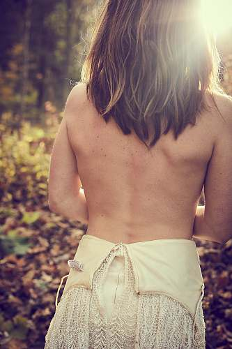 people woman top less near plants during daytime person