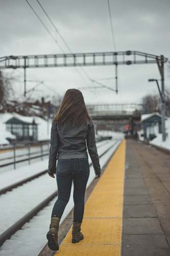 person woman walking beside the railway people