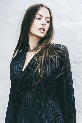 people woman wearing black blazer person