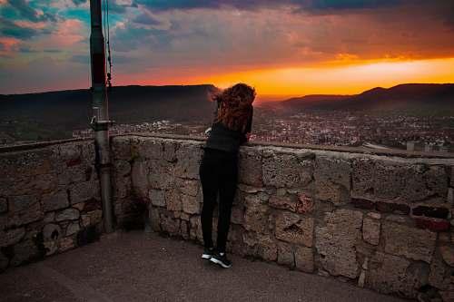 people woman wearing black legging during sunset person