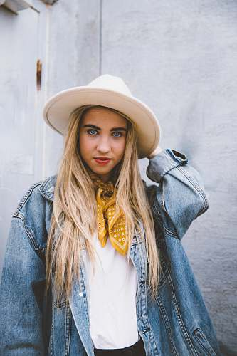 people woman wearing blue denim jacket and white hat hat
