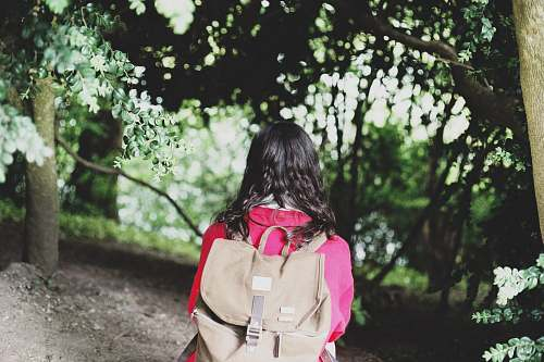 people woman wearing brown backpack person