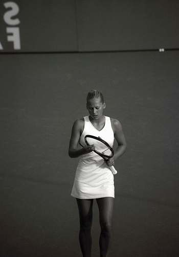 people woman wearing dress holding tennis racket black-and-white
