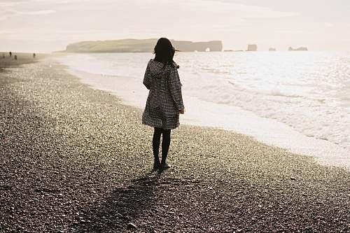 people women wearing white long-sleeved shirt on seashore person