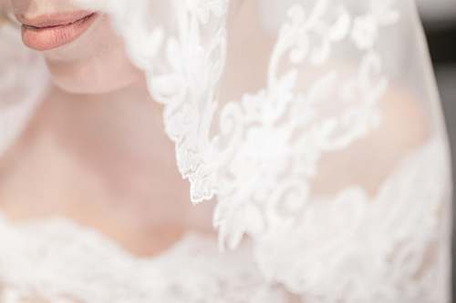 wedding macro shot of white veil bride