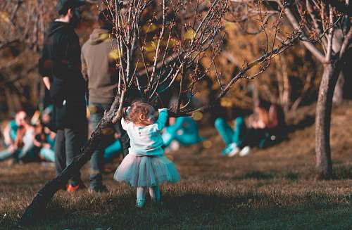 human baby in front of tree branch person