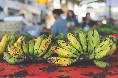 human bananas on red surface fruit