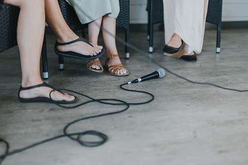 human black microphone on floor shoe