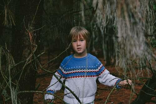 human boy standing near tree person