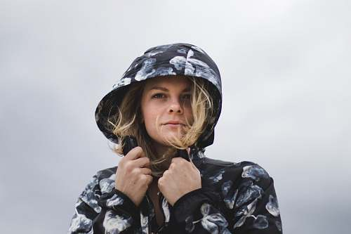 human close-up photography of woman wearing hoodie person
